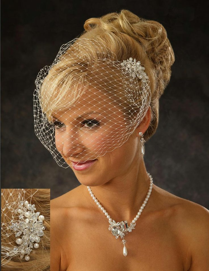 Lovely bird cage veil made of Russian net with pearl and rhinestones hair combs on either side. Item# BC-VR26