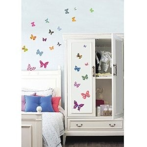 When it comes to feminine room ideas, you cant go wrong with a butterfly bedroom theme.A butterfly garden mural or a series of colorful butterfly wall stickers are a great place to start. Accessories for this girls bedroom idea include pink and yellow bedding with or without a butterfly motif along with hand painted furniture designs e.g. on drawer fronts, the headboard of the bed, on photo frames, on chair backs etc.