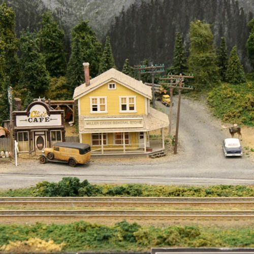 Model Train Scenery | Model railroad scene with a corner store, gas station, and moose on ...