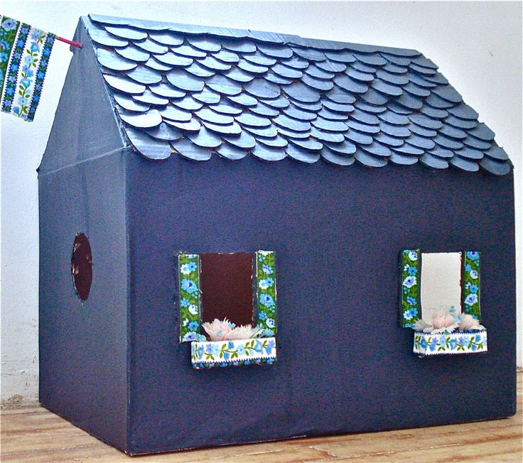 Recycled upcycled cardboard box into a kitty cat playhouse