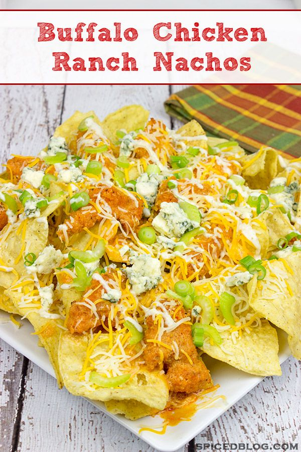 These Buffalo Chicken Ranch Nachos feature everything you love about buffalo wings…just in nacho form!  They're the perfect appetizer for the big game!