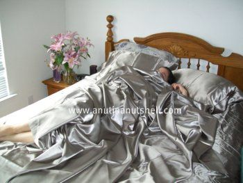 asleep in satin sheets | Sleeping, Slipping, and Sliding on Satin Sheets from ShopBedding.com