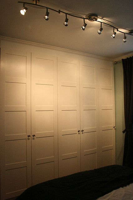 Ikea pax bergsbo white wardrobes installed with filler and crown molding