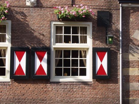The window shutters (luiken), like seen here, are very typical Dutch - Especially on an old farm house (boerderij).