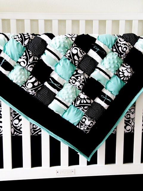 I really like the color combo in this baby puff quilt. There really aren't directions with the link but if you are really crafty you could make this. Doesn't look all that hard but would be time consuming.