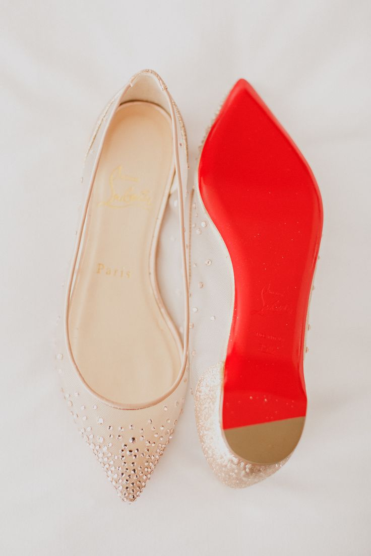 Sparkling Christian Louboutin flats are perfect for any Bride: http://www.stylemepretty.com/california-weddings/2014/12/10/classic-san-francisco-wedding-at-the-st-regis/ | Photography: Jennifer Skog - www.jenniferskog.com
