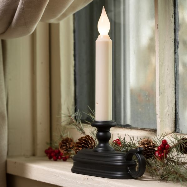 Give Your Home a Gorgeous Glow     The simplest touch can make a house a home. Our latest window candle elegantly illuminates with a white light for a bright, captivating glow. Battery operated and no unsightly cords, dusk till dawn sensor means they turn on when it's dark and off when it's not.     Two settings: flickering or full-on light    Sleek black base   Comes with clip to install in window wells   Safe, bright LED light   Lasts up to 45 days on just two C batteries (you supply)…
