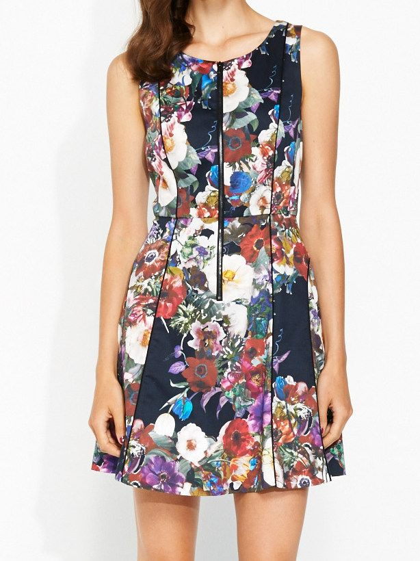 Versailles Floral Dress Line: 781692 Select Colour: Multi Vibrant and flattering fit and flare dress in colourful floral print. Features fitted bodice with exposed front zipper and contrast black piping detail. A great weekend dress. Style with black pumps and a tote. Fabric 97% Cotton 3% Elastane