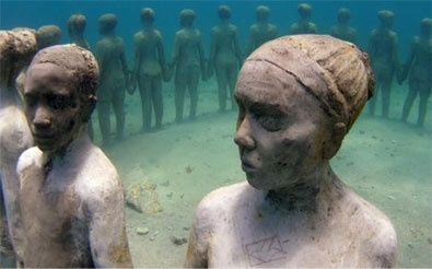 Figures stand in a circle in the underwater ruins of Cleopatra's Palace in ancient Alexandria, Egypt