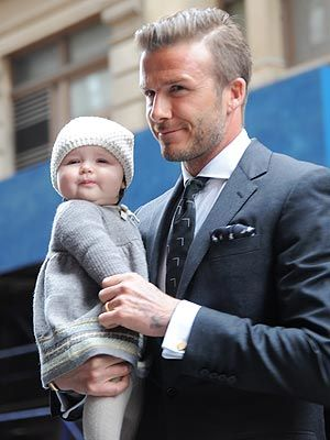 Could David Beckham get any hotter?  And I love that they have the same smirk in this pic!