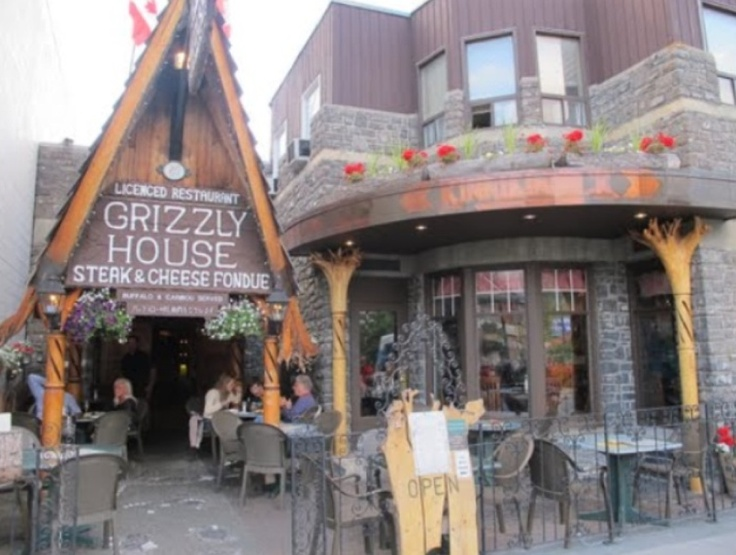 The Grizzly House in Banff has great food and a ridiculously entertaining atmosphere!