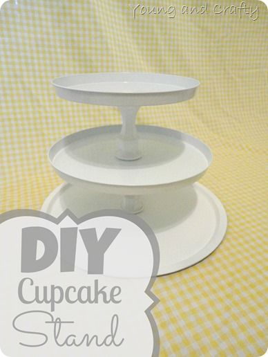 DIY Cupcake Stand using cheap candle holders, stove top covers, and a pizza pan
