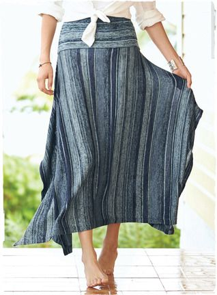Texturally striped in deep denim blues and silvery grey, our boho-chic, fine gauge knit skirt flows from a slim yoke to a dramatic handkerchief hem.