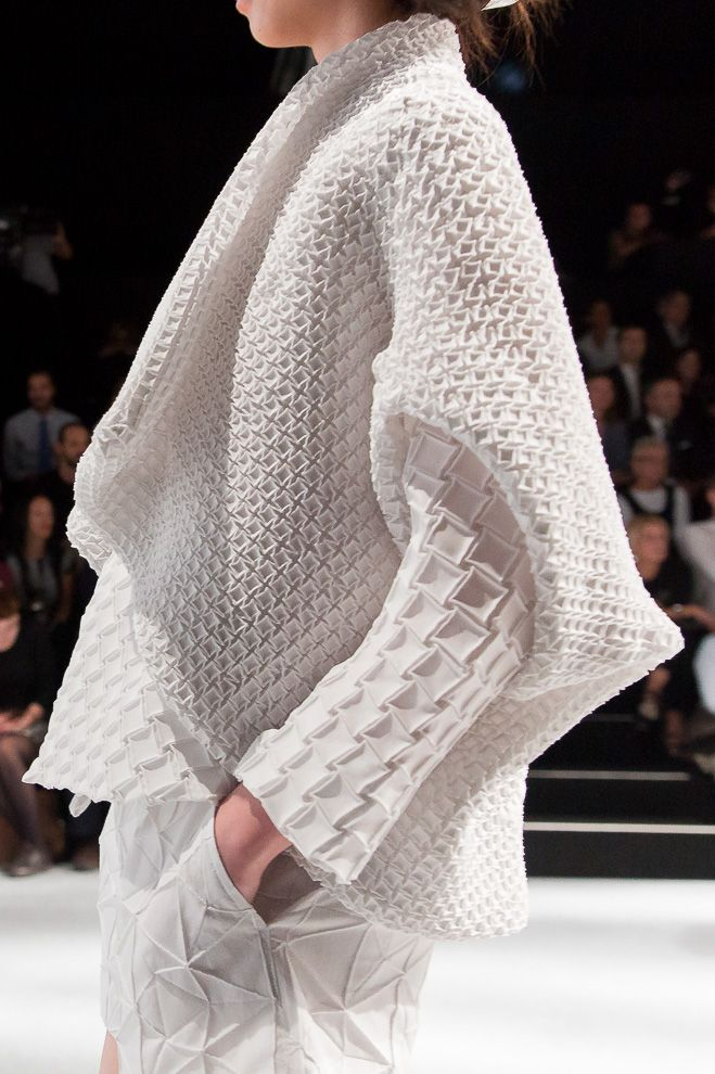 Pleated patterns with manipulated fabric textures; layered white fashion details // Issey Miyake SS15
