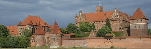 In Poland and the other Baltic States, Gothic forms made their way into the brick construction. The Malbork, the largest brick castle in the world, is the classic example of Gothic architecture in Poland.  Read more at Buzzle: http://www.buzzle.com/articles/style-and-characteristics-of-gothic-architecture.html