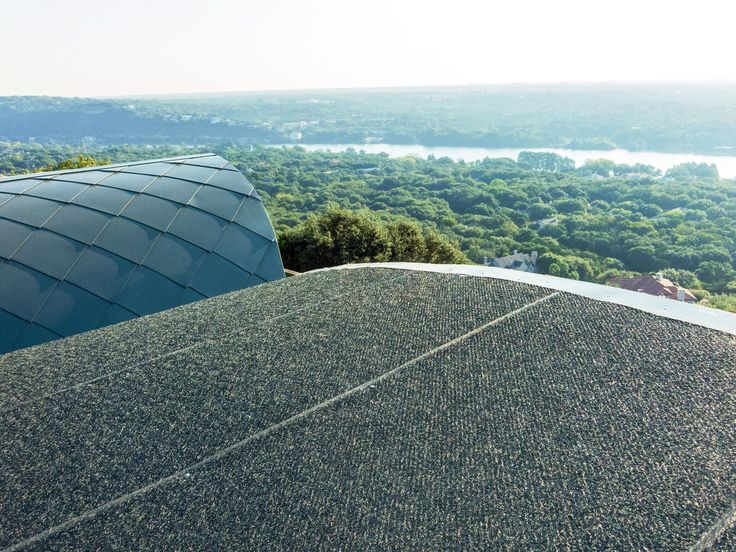 DELTA®-TRELA provided the ultimate protection from corrosion and moisture accumulation on this challenging, curvy roof with diamond-shaped zinc panels; which was especially important amidst the humid, windy Austin hills.    #customhome #architecture #building #buildingscience #roof #roofunderlayment #wrb #vaporpermeable #drainage #drainagecourse #drainagemat #fibermat #metalroofs #facade #metalcladding #DELTATRELA #mantahaus