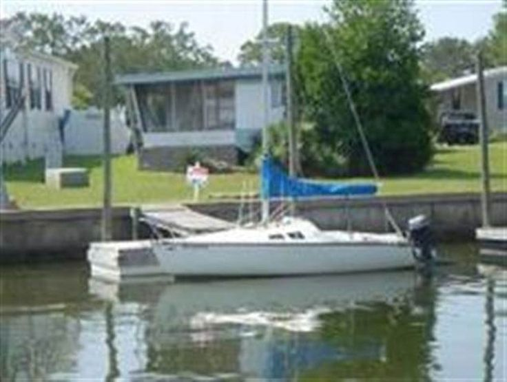 """For sale: $100,000. This lot has an old singlewide MH-Great for fisherman (sold """"as-is"""") nice driveway, floating dock, community pool, tennis court and HOA dues cuts your grass."""