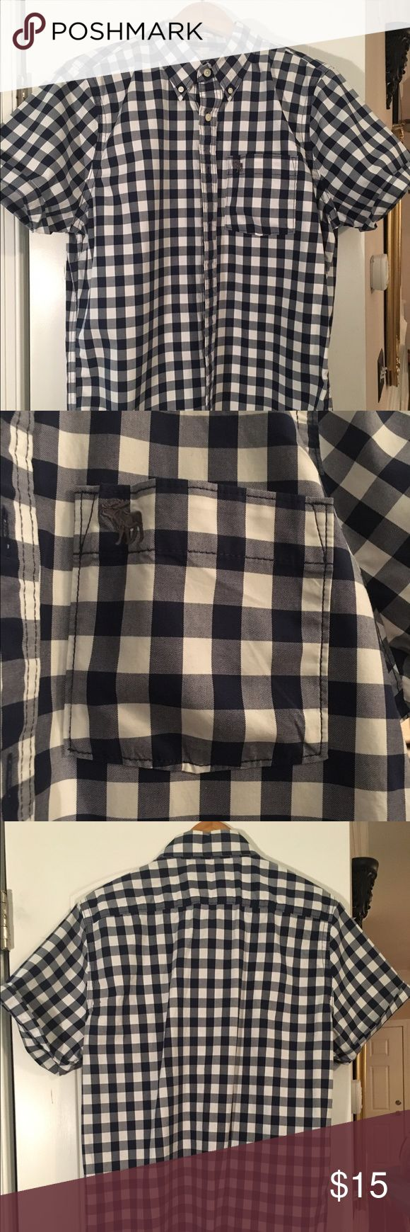 Abercrombie and Fitch short sleeve button up Like new Men's Abercrombie and Fitch muscle fit short sleeve button up. Blue block color size XXL. Abercrombie & Fitch Shirts Casual Button Down Shirts
