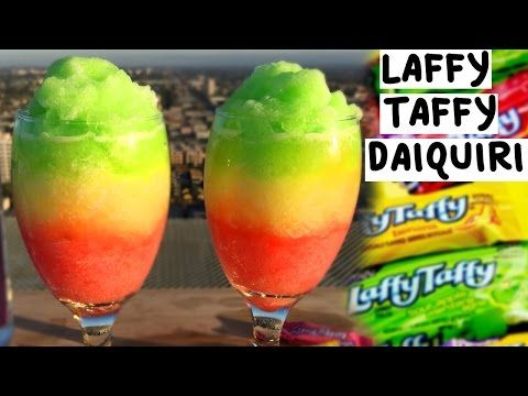 Laffy Taffy Daiquiri - Tipsy Bartender | We took Laffy Taffy candies, soaked them in rum and then blended them into a daiquiri. This is the ultimate summer treat!