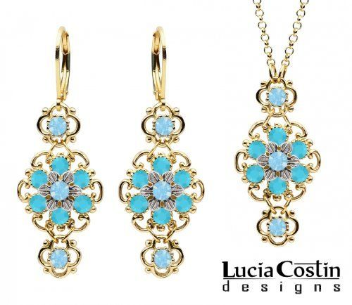 14K Yellow Gold Plated over .925 Sterling Silver Jewelry Set: Pendant and Earrings by Lucia Costin with Lovely Flowers, Ornate with Twisted Lines, Light Blue and Turquoise Swarovski Crystals Lucia Costin. $125.00. Style takes wings in this lovely jewelry set that have a graceful flower shape. Handmade in USA unique jewelry set. A perfect feminine touch. Lucia Costin delicate jewelry set. Decorated with aquamarine and turquoise Swarovski crystals