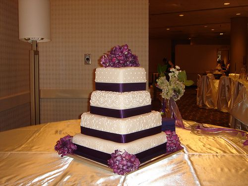 Custom square four tier fondant wedding cake with scroll work, purple ribbon and flowers 009