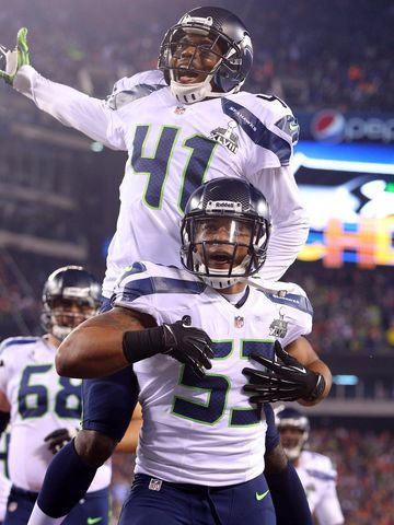 Seattle Seahawks outside linebacker Malcolm Smith (53) and cornerback Byron Maxwell (41) celebrate a touchdown during the first half against...