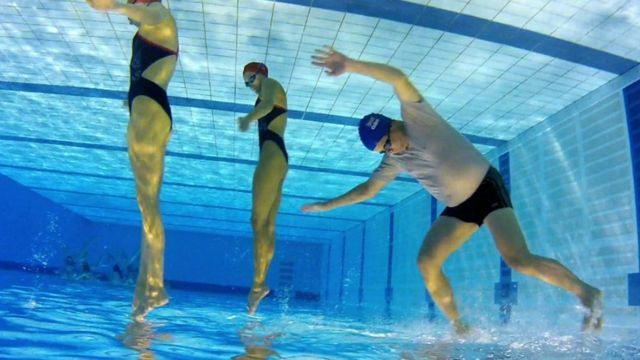 Mike Bushell and synchronised swimmers