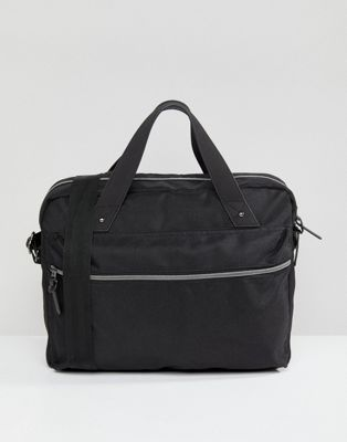 DESIGN satchel in black texture with internal laptop pouch and stud detail