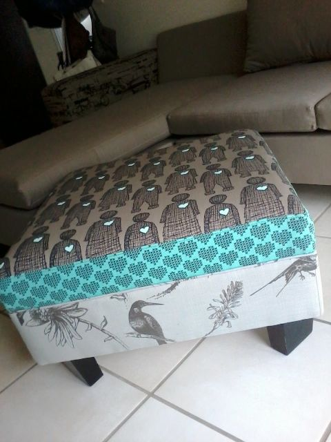Ottoman: re-upholstered in clay and aqua prints. Princess and the pea style.