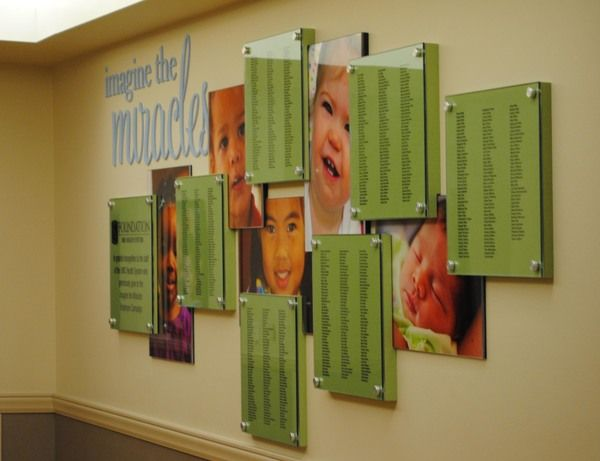 This unique and colorful display recognizes employee gifts toward the capital campaign. Names were screen printed and mounted behind glass for protection. Graphics of children are placed throughout the display to give the display personality and warmth.