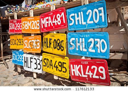Traditional handcrafted vehicle registration plates like souvenirs for sale in Trinidad, Cuba. - stock photo