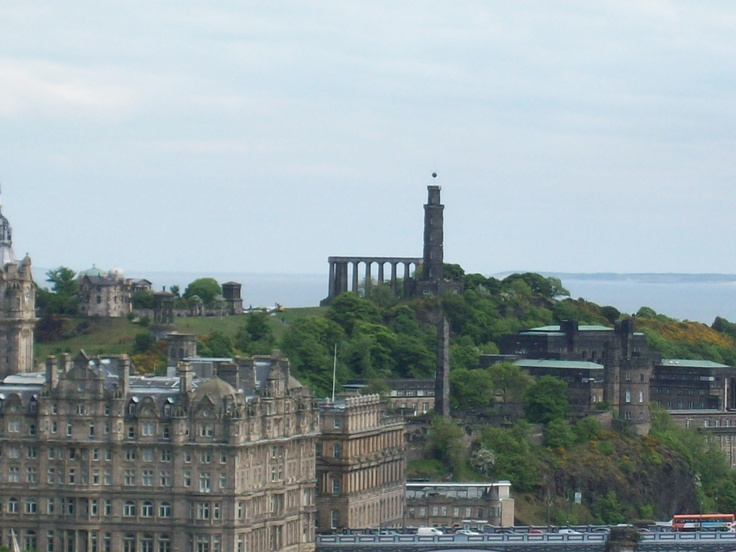 View of Calton hill from Edinburgh Castle.  The tower there is where they drop the ball when the 1 o'clock gun goes off every day.
