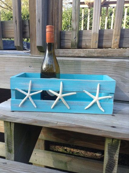 "Take this idea, buy a crate at Michaels, stain it in weathered gray, hot glue you ""finds"" (shells, starfish, whatever) on it."
