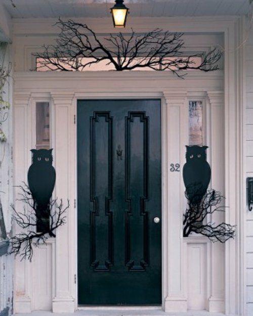 halloween außendekoration Pappeulen in Schwarz mit großen Augen