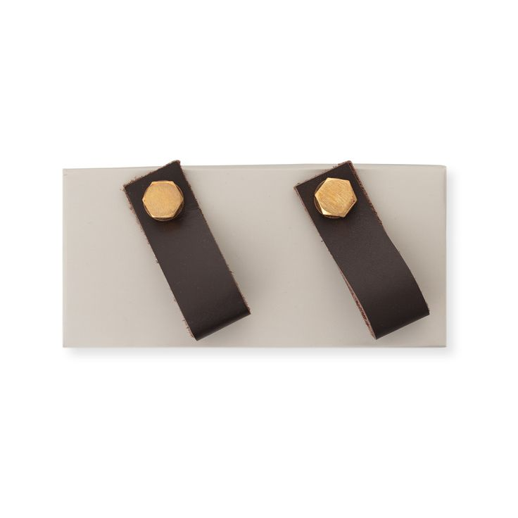 Decorative touches add an opulent mood and this Set of Two Leather & Gold Drawer Pulls brings tactile warmth and metallic lustre to storage furniture
