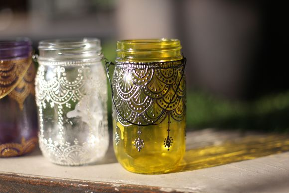Hand-Painted Mason Jar Lanterns. (puffy paint, glass paint, and mason jars)