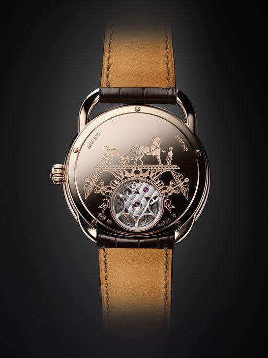 """La montre """"Arceau Lift"""" tourbillon volant d'Hermès http://www.vogue.fr/joaillerie/le-bijou-du-jour/diaporama/la-montre-arceau-lift-tourbillon-volant-d-hermes/15693#!2"""