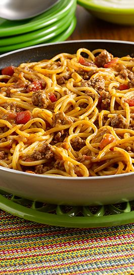 Taco Spaghetti Skillet: A Pot-Sized Pasta recipe with the flavor of tacos made in one pan using ground beef, zesty tomatoes and spaghetti, topped with sour cream
