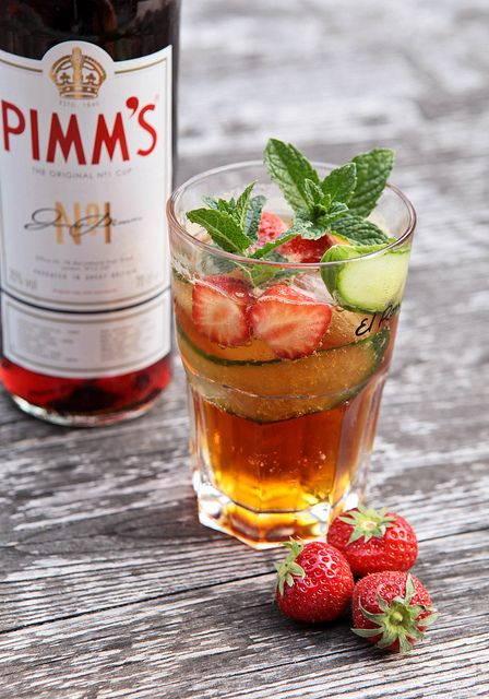 Pimm's, cucumber, mint, strawberry and Canada Dry cocktail - Add blackberries oranges and apples