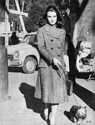 Audrey Hepburn in double-breasted tweed coat with shoulder-length hair