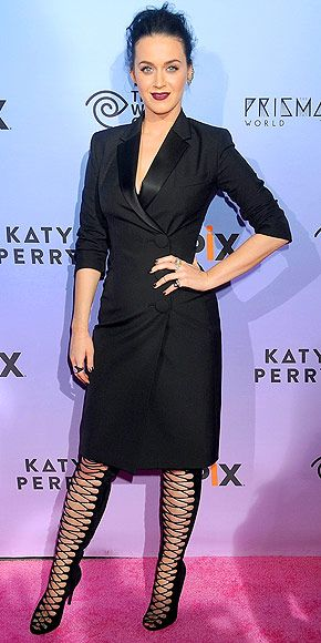 Last Night's Look: Love It or Leave It?   KATY PERRY   in a black Giambattista Valli suit-dress and lace-up boots with a bold deep-purple lip – which we definitely consider an accessory – at a screening of EPIX's Katy Perry: The Prismatic World Tour in L.A.