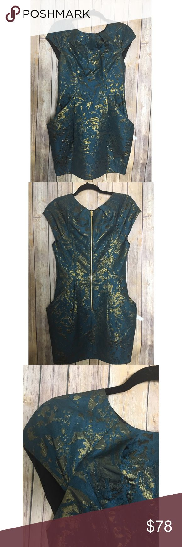 """AllSaints opulence baroque dress size 6 New without tags AllSaints Opulence metallic baroque women's dress size 6. Cap sleeve. Made from Jacquard fabric that has bronze lurex metallic effect. The dress has structures, close fitting bodice with a skirt that is an innovative and defined shape due to the way the material is folded. Absolutely breathtaking. US size 6 UK size 10. Teal and gold. Length from top of shoulder to bottom of dress is 32"""". Armpit to armpit 16"""". Waist about 28"""" All Saints…"""