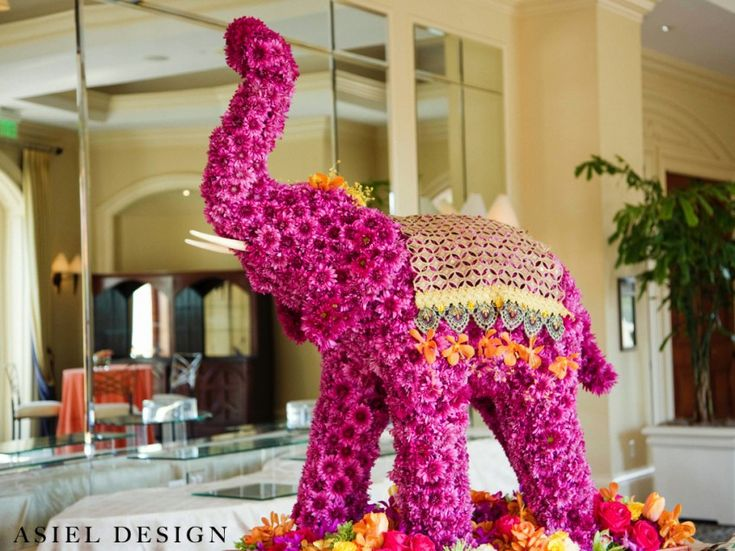 Love this floral elephant statue at the placecard table at an indian wedding reception