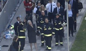 Theresa May meets with the emergency services outside Grenfell Tower.