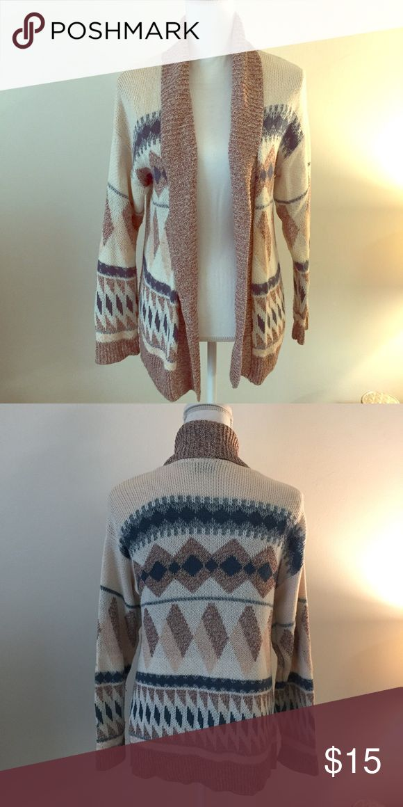 Cream Aztec print cardigan Cute cream colored cardigan with multicolored Aztec print. Worn a few times and in good condition. Urban Outfitters Sweaters Cardigans
