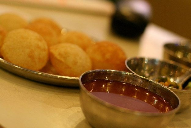 Panipuri |  fried spheres of goodness are stuffed with spiced potatoes and lentils, dipped in a sweet tamarind paste, and finished with a spicy green liquid concoction, before being served to you one at a time. It sounds complicated and messy, and you're pretty likely to choke at some point of the other, but it's all worth it when the first one breaks inside your mouth. The ultimate Bambaiyya bliss.