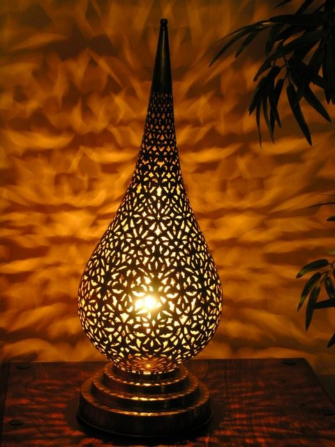 Trend Intricate brass lanterns casting a myriad of shadows across your room add a sense of the