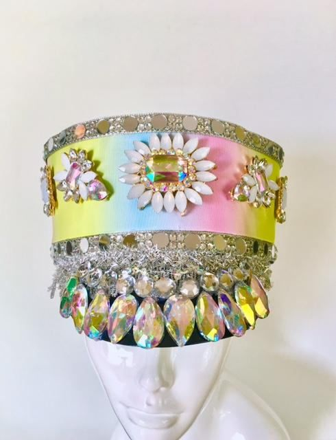This gorgeous conductor hat is the perfect accessory for a festival or photoshoot!  Embellished with iridescent gems , trims and jewels ! And holographic sequins  Fits an adult head comfortably.  Ready to ship out