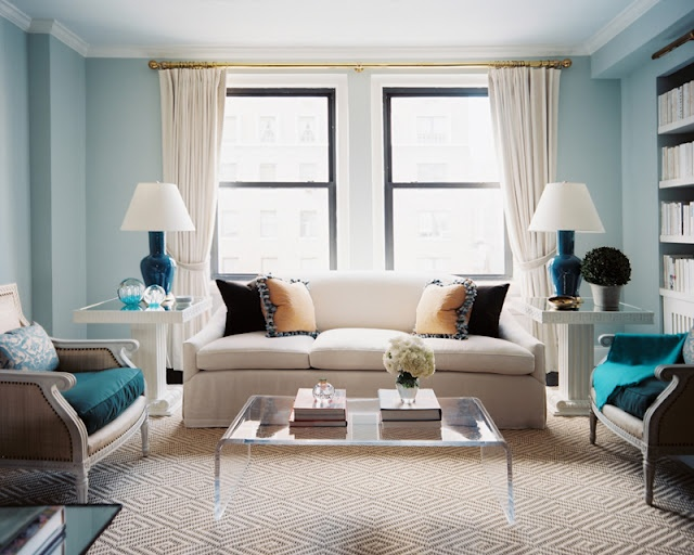 soft blue walls here with a light carpet create a sense of calm and spaciousness.