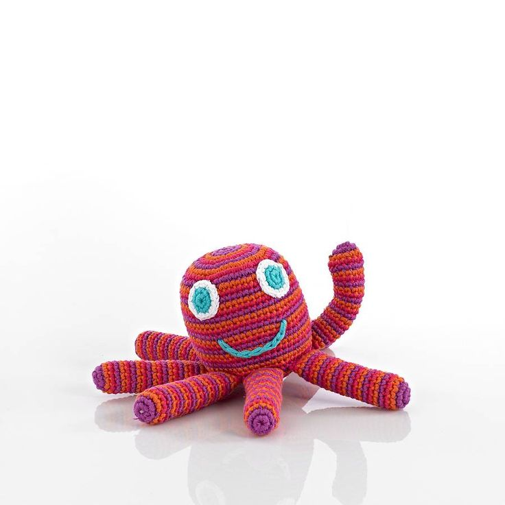 This popular octopus rattle soft toy has been hand crocheted. It has a big eyes, a friendly smile and a rattle inside.Available in two gorgeous colours: blue or pink, why not get one of each so they can have lots of fun adventures together. Suitable from birth though older children love them too! We offer free gift wrapping, we use stripy colourful paper bags and provide a off white strung gift tag on which we can hand write a message for you.Did you know that octopi have three hearts?…